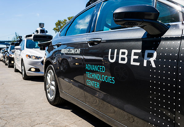 Uber's self-driving car kills Arizona woman crossing the street; Uber halts autonomous-car testing