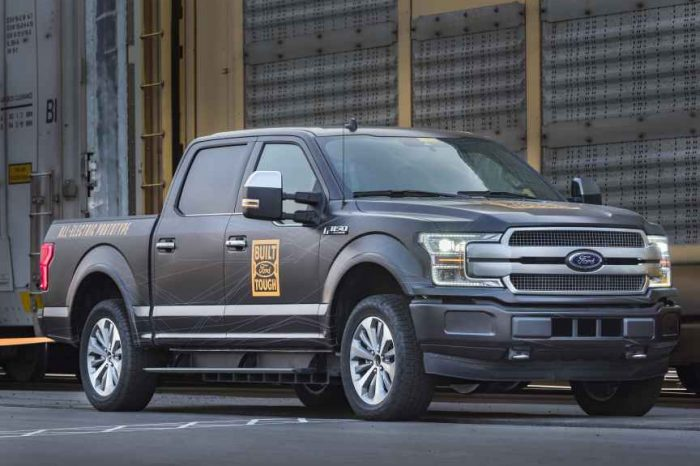 Ford takes on Tesla with a new all-electric F-150 truck that pulls over a million-pound train
