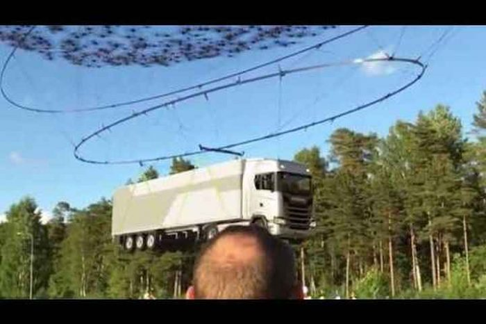 Can you pick up a 40-ton truck with 2,000 drones?