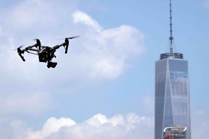 "Anti-COVID-19 drones flying above New York metro-area urging pedestrians to ""maintain social distancing."""