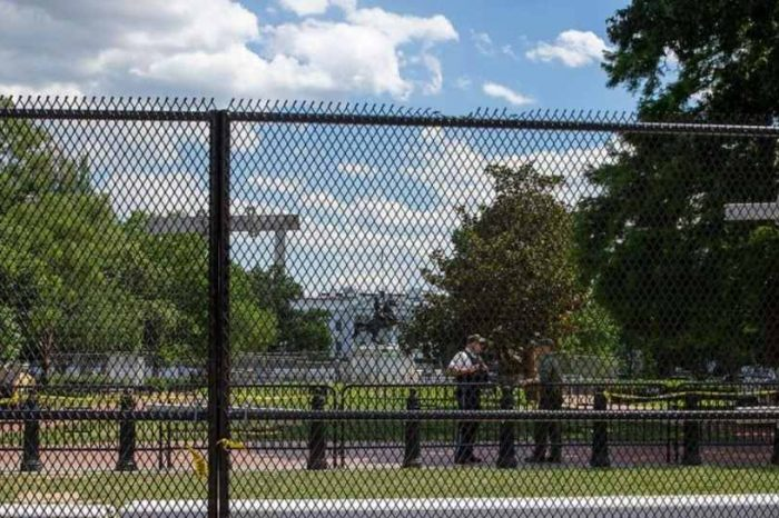"""The White House on lockdown: """"Non-scalable"""" fence built around White House plus 250 soldiers on standby to handle election night chaos"""