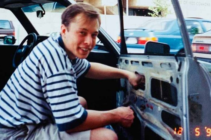 This is Elon Musk in 1995, fixing his car by himself because he couldn't afford to pay for repairs