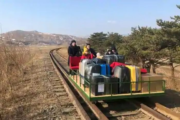 Russian diplomats leave North Korea using old hand-pushed trolley