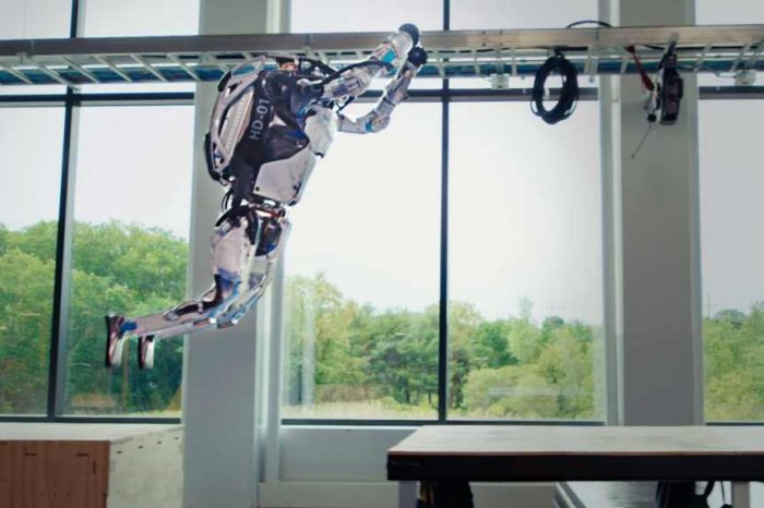 Boston Dynamics' backflipping robot Atlas is back with new skills: Now shows of its new parkour routine and obstacle jumps